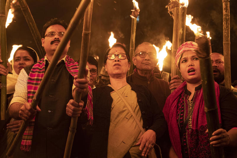 Indians participate in a torch light procession to protest against the Citizenship Amendment Bill (CAB) in Gauhati, India, Monday, Dec. 9, 2019. The bill that seeks to grant Indian citizenship to non-Muslim refugees from Pakistan, Bangladesh and Afghanistan is being debated in the Indian Parliament. (AP Photo/Anupam Nath)