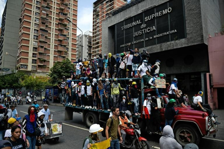 The Supreme Court says journalist and opposition figure Roland Carreno provided logistics for a failed military incursion aimed at toppling President Nicolas Maduro