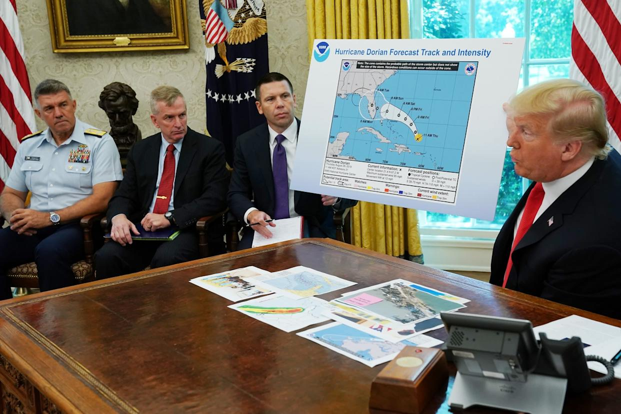 Donald Trump addresses reporters while holding doctored map: Getty Images