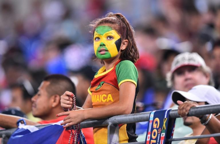 A young Jamaican fan watches Jamaica play Haiti during a CONCACAF Gold Cup quarterfinal football match in Baltimore on July 18, 2015