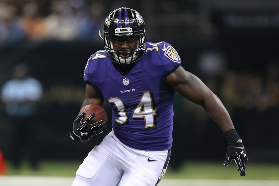 NEW ORLEANS, LA - AUGUST 28:   Lorenzo Taliaferro #34 of the Baltimore Ravens against the New Orleans Saints at the Mercedes-Benz Superdome on August 28, 2014 in New Orleans, Louisiana.  (Photo by Chris Graythen/Getty Images)