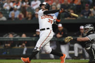 Baltimore Orioles' Renato Nunez follows through on an RBI-double against the Chicago White Sox in the first inning of a baseball game, Wednesday, April 24, 2019, in Baltimore. (AP Photo/Gail Burton)