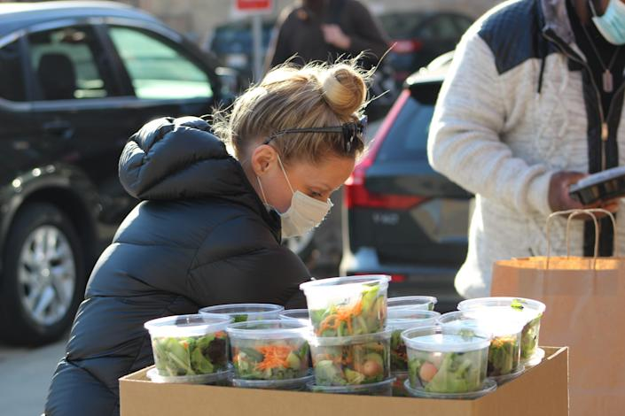 Emily Bugg prepares Thanksgiving meal packages for delivery to Thresholds clients.
