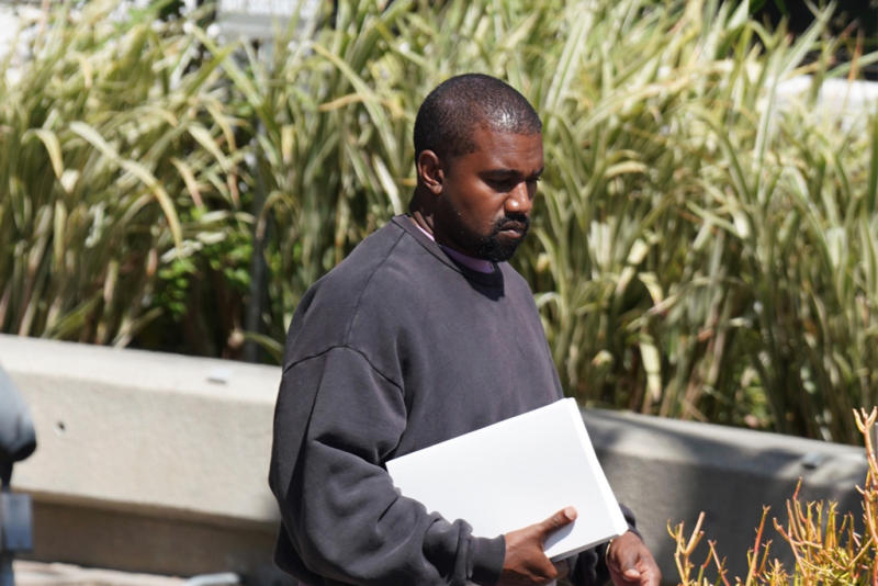 cheaper 8d5a7 13b89 Kanye West Casually Steps Out in an Unreleased Adidas Yeezy ...