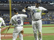Tampa Bay Rays' Mike Zunino, right, celebrates his two-run home run with Brandon Lowe (8) during the fifth inning of a baseball game against the Miami Marlins, Saturday, Sept. 25, 2021, in St. Petersburg, Fla. (AP Photo/Steve Nesius)