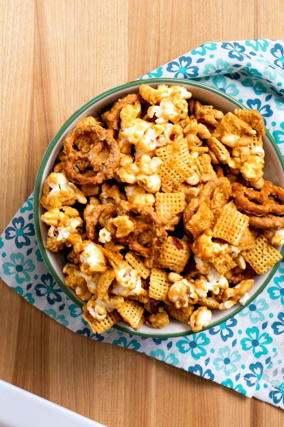 """<p>Sweet and salty snacks, like this party mix, are perfect for munching on throughout the day. It's a great way to stay satisfied until the turkey is ready. </p><p><a href=""""https://www.thepioneerwoman.com/food-cooking/recipes/a32257596/mercantile-snack-mix-recipe/"""" rel=""""nofollow noopener"""" target=""""_blank"""" data-ylk=""""slk:Get Ree's recipe."""" class=""""link rapid-noclick-resp""""><strong>Get Ree's recipe.</strong></a></p>"""