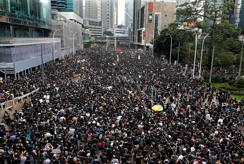 Protesters march on the streets against an extradition bill in Hong Kong on Sunday.