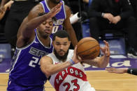 Toronto Raptors guard Fred VanVleet, right, passes the ball as Sacramento Kings guard Buddy Hield defends during the first quarter of an NBA basketball game in Sacramento, Calif., Friday, Jan. 8, 2021. (AP Photo/Rich Pedroncelli)