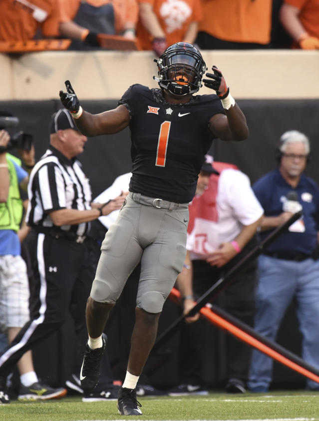 Oklahoma State linebacker Calvin Bundage celebrates during an NCAA college football game against South Alabama, in Stillwater, Okla., Saturday, Sept. 8, 2018. (AP Photo/Brody Schmidt)