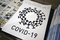 FILE - In this May 19, 2020, file photo, the cover design of Number 1 Shimbun is seen in Tokyo, Tuesday, May 19, 2020. The Foreign Correspondents' Club of Japan removed a parody drawing that uses the Tokyo Olympic logo combined with features of the COVID-19 virus from their website after receiving a demand for withdrawal from the organizing committee. (AP Photo/Eugene Hoshiko, File)