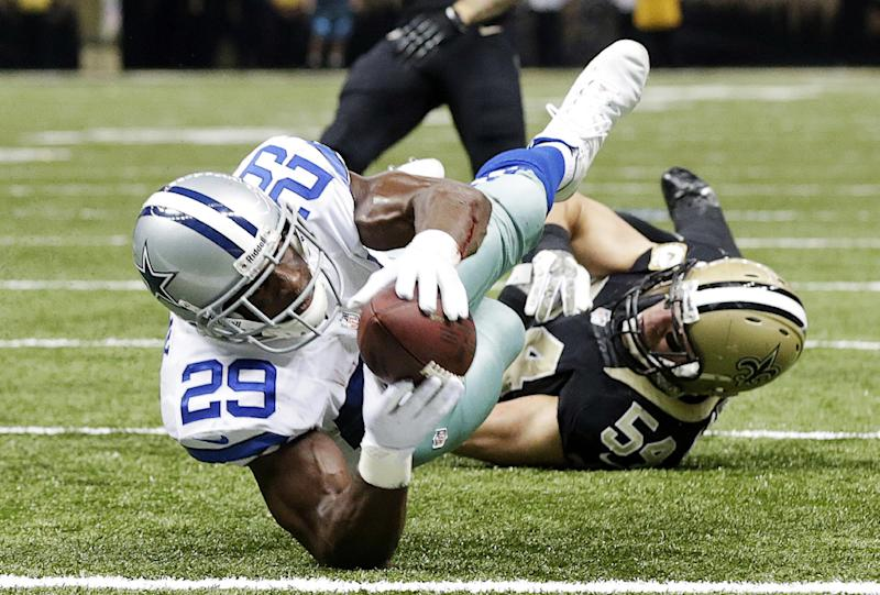 Dallas Cowboys running back DeMarco Murray (29) scores a touchdown in front of New Orleans Saints outside linebacker Will Herring in the first half of an NFL football game in New Orleans, Sunday, Nov. 10, 2013. (AP Photo/Dave Martin)