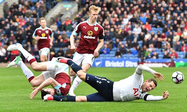 <p>Tottenham's Vincent Janssen goes down as Burnley's Ben Mee looks on </p>