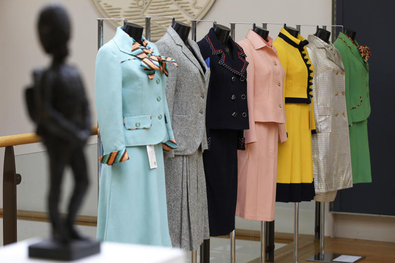 FILE - This is a Thursday, Aug. 30, 2012 file photo of the  business suits of former British Prime Minister Margaret Thatcher seen on display at Christie's auction house in London. The turquoise wool suit, nearest the camera,  that Margaret Thatcher wore on the day she was confirmed as Conservative Party leader has sold at auction for 25,000 pounds (US$39,670) on Monday Sept. 3, 2012. (AP Photo/Sang Tan, File)