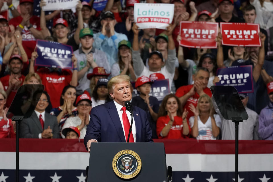 "FILE - In this Feb. 19, 2020, file photo President Donald Trump pauses as he speaks at a rally in Phoenix. Public health officials were already warning Americans about the need to prepare for the coronavirus threat in early February when President Donald Trump called it ""deadly stuff"" in a private conversation that has only now has come to light. (AP Photo/Rick Scuteri, File)"