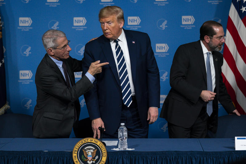 Dr. Anthony Fauci, director of the National Institute of Allergy and Infectious Diseases, left, President Donald Trump, center, and Secretary of Health and Human Services Alex Azar leave a briefing on the coronavirus at the National Institutes of Health, Tuesday, March 3, 2020, in Bethesda, Md. (AP Photo/Evan Vucci)