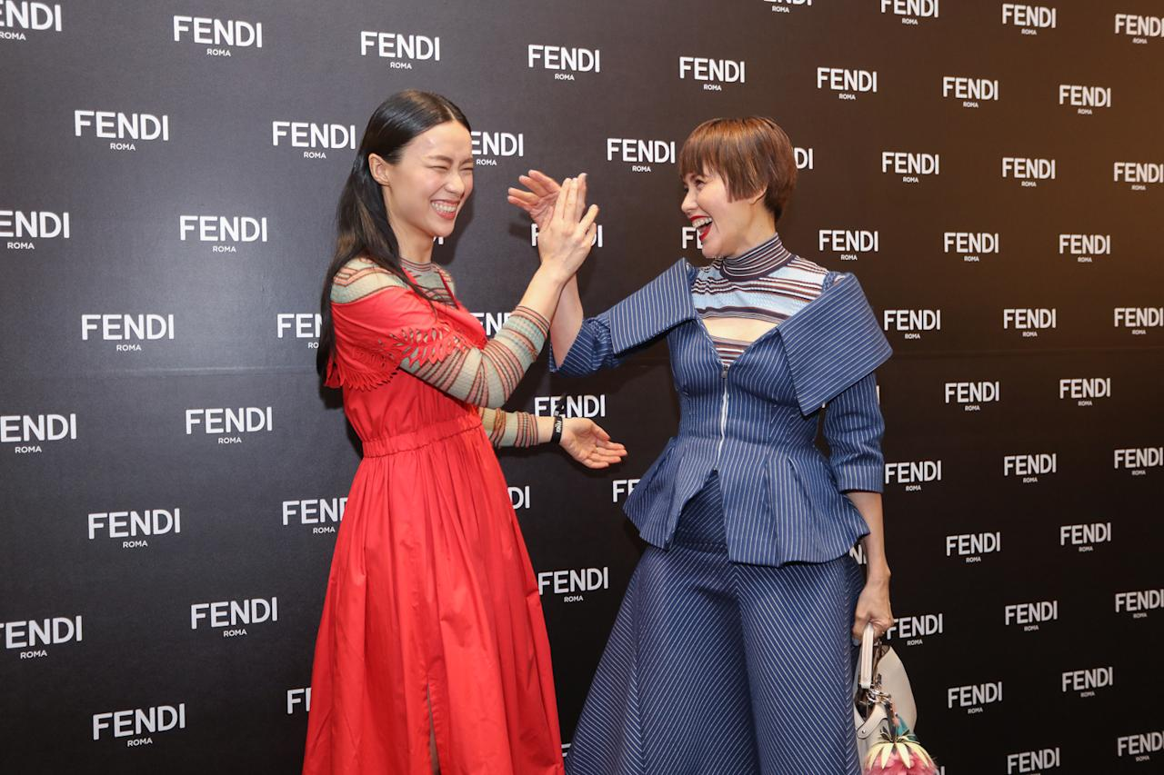 <p>Rebecca Lim and Zoe Tay showed off fun poses for the camera.<br /> (Photo: Don Wong) </p>