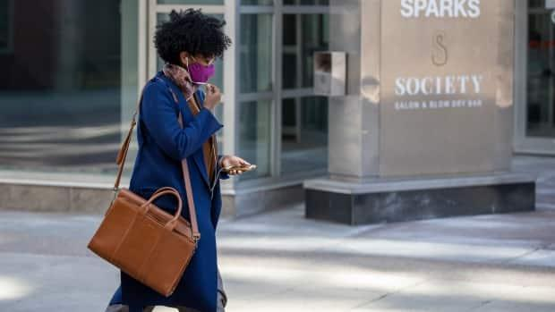 A pedestrian wearing a mask in downtown Ottawa on April 26, 2021. (Andrew Lee/CBC - image credit)