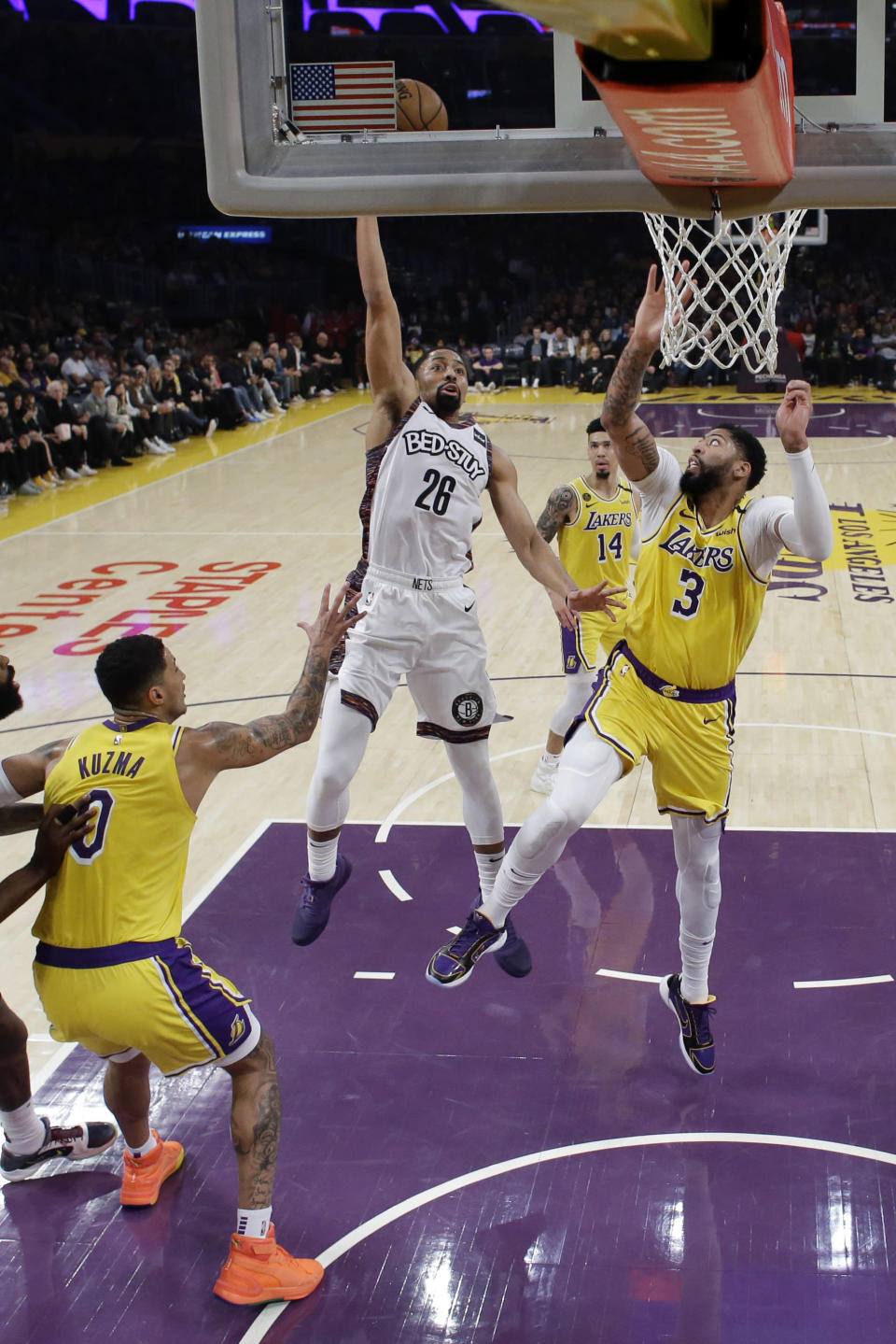 Brooklyn Nets' Spencer Dinwiddie (26) shoots over Los Angeles Lakers' Anthony Davis (3) during the first half of an NBA basketball game Tuesday, March 10, 2020, in Los Angeles. (AP Photo/Marcio Jose Sanchez)