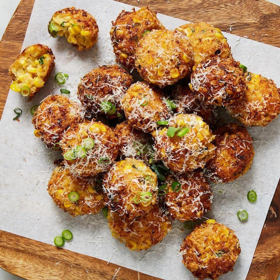 "<p>These savoury bites have earned a notorious reputation here at Delish—they're pretty impossible to stop eating. The contrast of <a href=""https://www.delish.com/uk/cooking/recipes/a30165633/corn-on-the-cob/"" rel=""nofollow noopener"" target=""_blank"" data-ylk=""slk:sweet juicy corn"" class=""link rapid-noclick-resp"">sweet juicy corn</a>, salty parmesan, and bright spring onions is pretty unbeatable. These poppers are definitely one of our all-time favourite corn recipes.</p><p>Get the <a href=""https://www.delish.com/uk/cooking/recipes/a33939708/cheesy-corn-poppers-recipe/"" rel=""nofollow noopener"" target=""_blank"" data-ylk=""slk:Cheesy Corn Poppers"" class=""link rapid-noclick-resp"">Cheesy Corn Poppers</a> recipe.</p>"