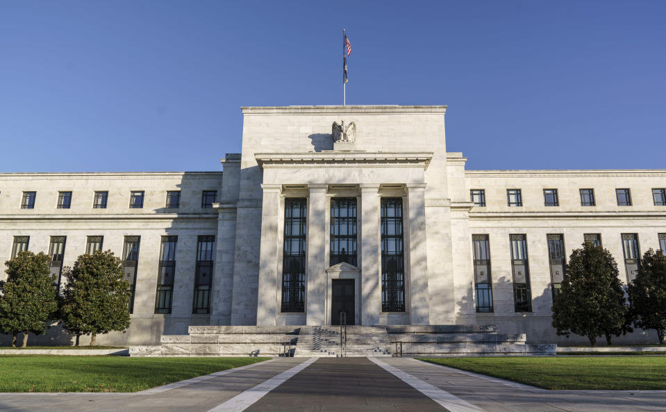 FILE - The Federal Reserve is seen in Washington, in this Nov. 16, 2020 file photo. The Federal Reserve this week will likely underscore its commitment to its low-interest rate policies, even as the economy recovers further from the devastation of the viral pandemic. The Fed's latest policy meeting ends Wednesday, Jan. 27, 2021. (AP Photo/J. Scott Applewhite, File)