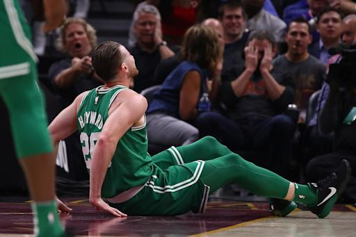 Gordon Hayward sits on the floor after being injured while playing the Cleveland Cavaliers. (Getty)