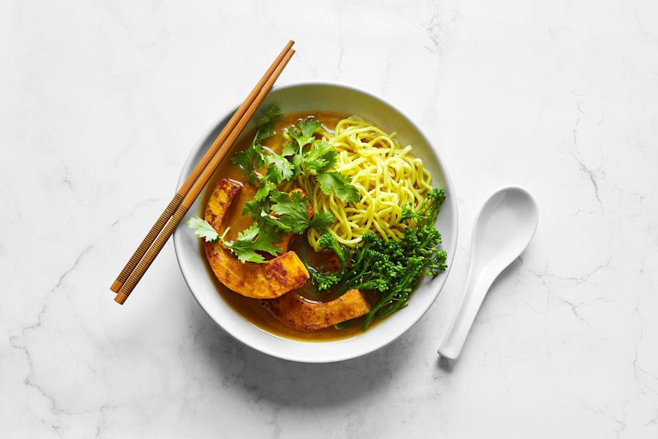 """To make this <a href=""""https://www.epicurious.com/expert-advice/best-vegetarian-ramen-roast-your-squash-with-miso-article?mbid=synd_yahoo_rss"""" rel=""""nofollow noopener"""" target=""""_blank"""" data-ylk=""""slk:new recipe from Hetty McKinnon"""" class=""""link rapid-noclick-resp"""">new recipe from Hetty McKinnon</a>, you'll roast the squash (with a bit of miso rubbed on) and keep some of it in wedges. The rest gets blended into the savory broth for a velvety texture. If you're thinking ahead to next week, though, we recommend cooking a little extra squash, since it's great to have around for filling sandwiches or topping bowls of savory oatmeal, congee, or hummus. <a href=""""https://www.epicurious.com/recipes/food/views/miso-squash-ramen-hetty-mckinnon?mbid=synd_yahoo_rss"""" rel=""""nofollow noopener"""" target=""""_blank"""" data-ylk=""""slk:See recipe."""" class=""""link rapid-noclick-resp"""">See recipe.</a>"""