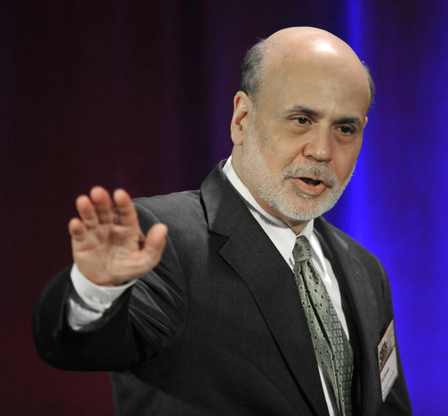 FILE - In this May 10, 2013 file photo, Federal Reserve Chairman Ben Bernanke waves goodbye after speaking during a banking conference in Chicago. When Bernanke testifies about the U.S. economy Wednesday, May 22, 2013, the Federal Reserve chairman's words will be examined for any clues that the Fed might soon taper _ or increase _ its support for the economy. (AP Photo/Paul Beaty, File)