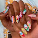 """<p> If you're keen to take the prints that make up your world into your nail art, the trend of maximalist multiprint should help take look to the next lev. The method? Joyfully clash colours, prints and textures around one particular theme. </p><p>Artist Anouska Anastasia painted these lengths to celebrate South Asian Truck art as part of a client request, and we think the result is divine. </p><p><a href=""""https://www.instagram.com/p/CHQu36aDiKY/"""" rel=""""nofollow noopener"""" target=""""_blank"""" data-ylk=""""slk:See the original post on Instagram"""" class=""""link rapid-noclick-resp"""">See the original post on Instagram</a></p>"""