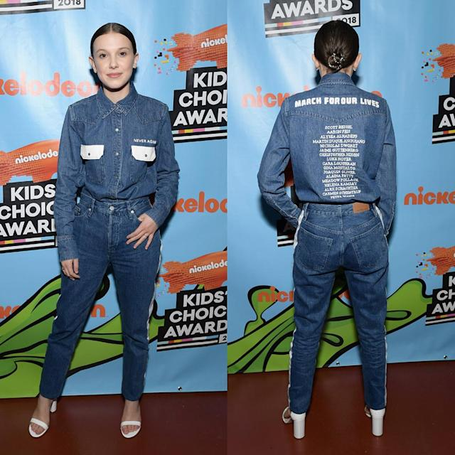 "<p>The <em>Stranger Things</em> star paid tribute to the 17 victims of the Marjory Stoneman-Douglas school schooting, at Nickelodeon's 2018 Kids' Choice Awards on Saturday by wearing their names on the back of her shirt. The front of the chambray button down, which was designed by Calvin Klein, read ""Never again."" (Photo: Emma McIntyre/KCA2018/Getty Images) </p>"