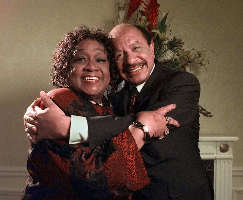 """FILE - In this May 6, 1998 file photo, Isabel Sanford, left, and Sherman Hemsley, stars the television sitcom """"The Jeffersons,"""" pose for a photograph in New York. Hemsley, the actor who made the irascible, bigoted George Jefferson of """"The Jeffersons"""" one of television's most memorable characters and a symbol for urban upward mobility, was found dead Tuesday, July 24, 2012 at his El Paso, Texas home. He was 74.(AP Photo/Kathy Willens, File)"""