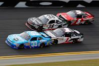 DAYTONA BEACH, FL - FEBRUARY 25: Tony Stewart, driver of the #33 Oreo/Ritz Chevrolet, is pushed by Kurt Busch, driver of the #1 HendrickCars.com Chevrolet, as Kasey Kahne, driver of the #38 Great Clips Chevrolet, is pushed by Dale Earnhardt Jr., driver of the #5 TaxSlayer.com Chevrolet, during the NASCAR Nationwide Series DRIVE4COPD 300 at Daytona International Speedway on February 25, 2012 in Daytona Beach, Florida. (Photo by Streeter Lecka/Getty Images)