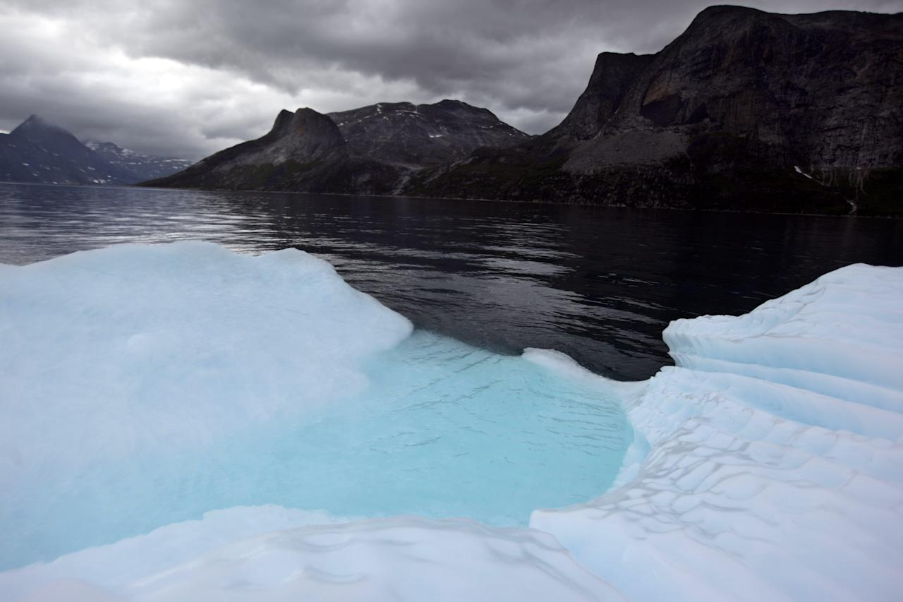 In this July 26, 2011 photo, a melting iceberg floats along a fjord leading away from the edge of the Greenland ice sheet, near Nuuk, Greenland. (AP Photo/Brennan Linsley)