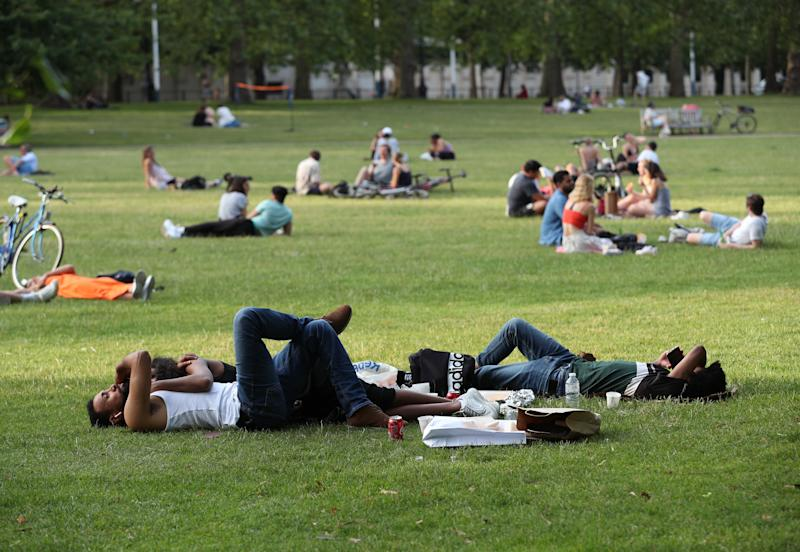 People relaxing in St James's Park, London, as further coronavirus lockdown restrictions are lifted in England. (Photo by Yui Mok/PA Images via Getty Images)