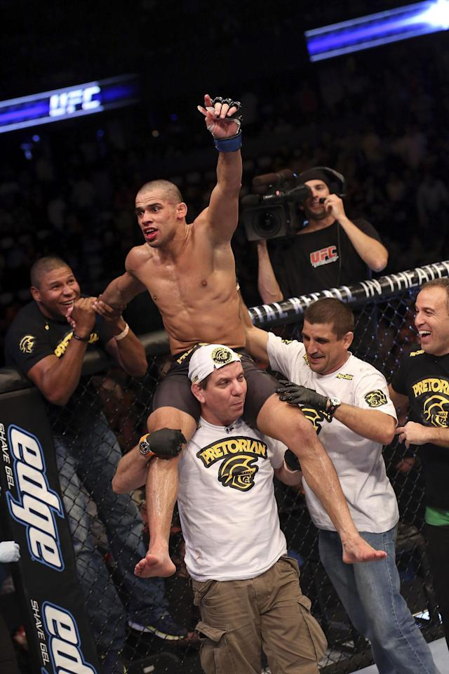 Renan Barao celebrates with his team after his victory over Urijah Faber after their UFC interim bantamweight championship bout at UFC 149 inside the Scotiabank Saddledome on July 21, 2012 in Calgary, Alberta, Canada. (Photo by Nick Laham/Zuffa LLC/Zuffa LLC via Getty Images)