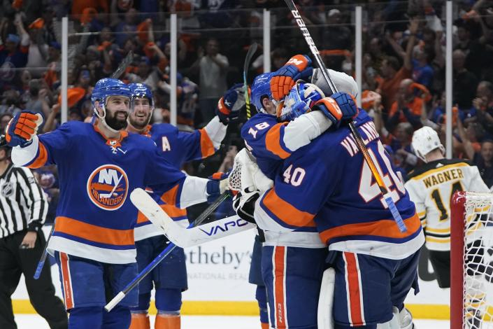 New York Islanders goaltender Semyon Varlamov (40) celebrates with teammates after of Game 6 in an NHL hockey second-round playoff series against the Boston Bruins Wednesday, June 9, 2021, in Uniondale, N.Y. The Islanders won 6-2. (AP Photo/Frank Franklin II)