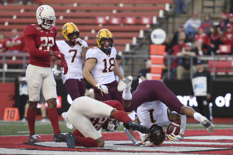 Minnesota running back Rodney Smith (1) flips into the end zone to score a touchdown during the second half of an NCAA college football game against Rutgers Saturday, Oct. 19, 2019, in Piscataway, N.J. (AP Photo/Sarah Stier)
