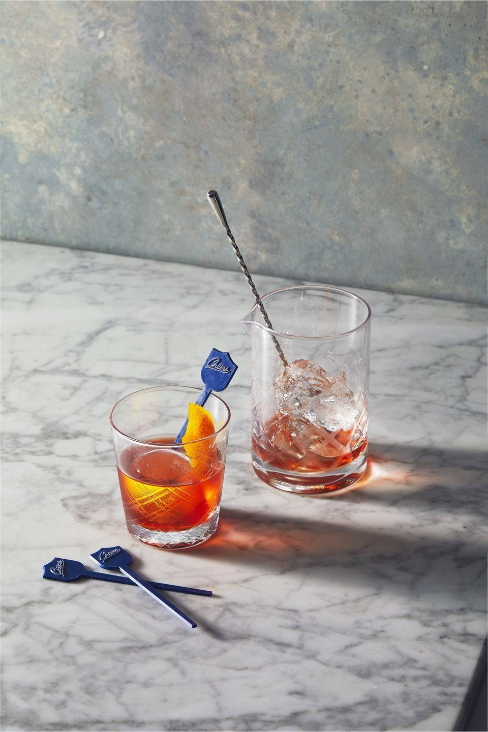 <p>This classic aperitif (best enjoyed before dinner!), first created in Florence, Italy in 1919, is the perfect balance of bitter and citrusy. In a cocktail shaker filled with ice, stir 1oz gin, 1 oz Campari and 1 oz sweet vermouth. Strain into a rocks glass filled with ice and serve with an orange twist.</p>