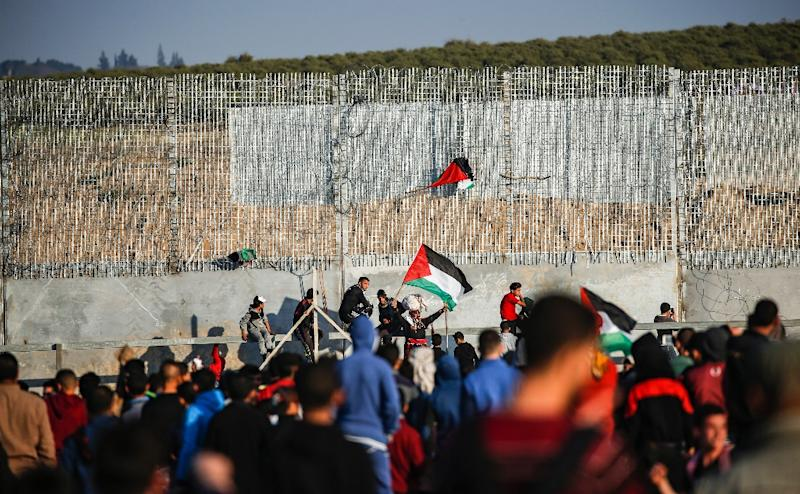 Two Palestinians were killed Friday by Israeli fire on the Gaza border, the enclave's health ministry said
