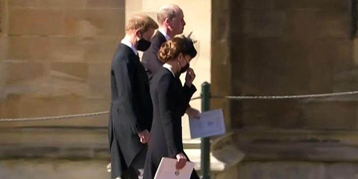 William, Harry and Kate, the Duchess of Cambridge, walked together as they left St. George's Chapel.  (NBC)