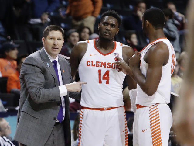 Clemson head coach Brad Brownell, left, talks to Elijah Thomas (14) and Aamir Simms (25). (AP Photo/Frank Franklin II)