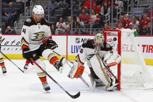 Anaheim Ducks defenseman Cam Fowler (4) deflects a Detroit Red Wings shot past Anaheim Ducks goaltender John Gibson (36) in the second period of an NHL hockey game, Tuesday, Oct. 8, 2019, in Detroit. (AP Photo/Paul Sancya)
