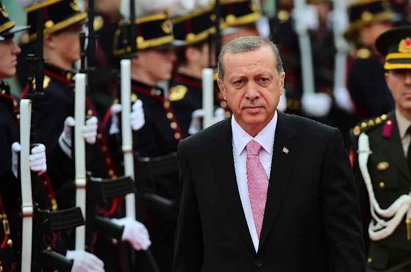Turkey's President Recep Tayyip Erdogan reviews an honour guard in Brussels on October 5, 2015
