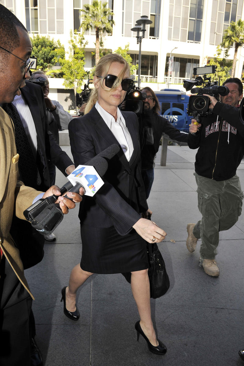 """LOS ANGELES, CA - MARCH 01: Nicollette Sheridan arrives in court where she will be taking the stand for opening arguments in her """"Desperate Housewives"""" lawsuit at County Courthouse on March 1, 2012 in Los Angeles, California. Sheridan is claiming that killing her character, Edie Britt, is wrongful termination of employment.  (Photo by Toby Canham/Getty Images)"""