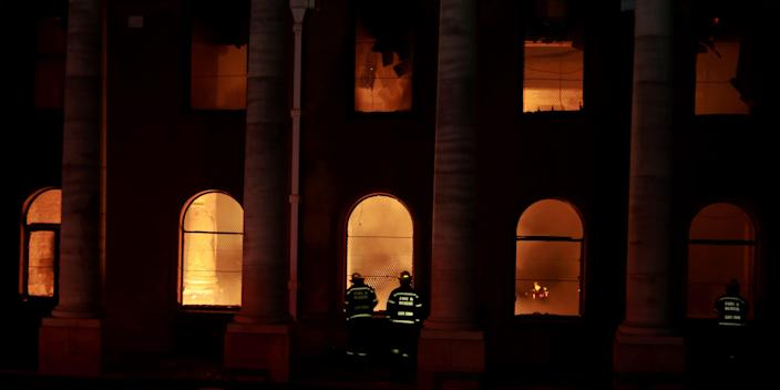 vFirefighters douse the destroyed Jagger Library at the University of Cape Town, South Africa, Sunday, April 18, 2021.