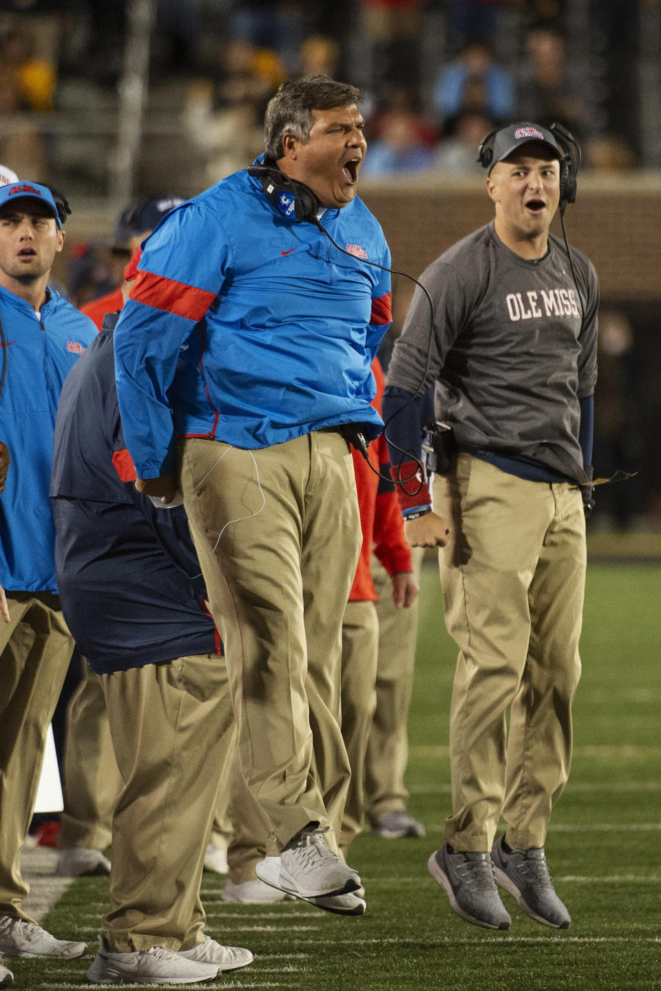 Mississippi head coach Matt Luke, left, jumps in the air during the final seconds of the second quarter of an NCAA college football game against Missouri Saturday, Oct. 12, 2019, in Columbia, Mo. (AP Photo/L.G. Patterson)