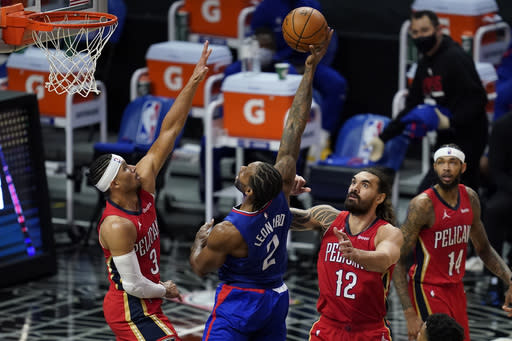 Los Angeles Clippers forward Kawhi Leonard (2) shoots between New Orleans Pelicans guard Josh Hart (3) and center Steven Adams (12) during the second quarter of an NBA basketball game Wednesday, Jan. 13, 2021, in Los Angeles. (AP Photo/Ashley Landis)