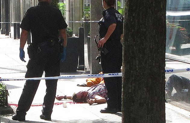 WARNING: GRAPHIC CONTENT. A man lies wounded on the ground after a tragic shooting at the Empire State Building in New York City. Twitter photo courtesy of Ben Doernberg (@UpdateBen)