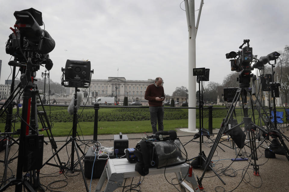 Television equipment is set up in front of Buckingham Palace in London, Monday, March 8, 2021. Britain's royal family is absorbing the tremors from a sensational television interview by Prince Harry and the Duchess of Sussex, in which the couple said they encountered racist attitudes and a lack of support that drove Meghan to thoughts of suicide. (AP Photo/Kirsty Wigglesworth)