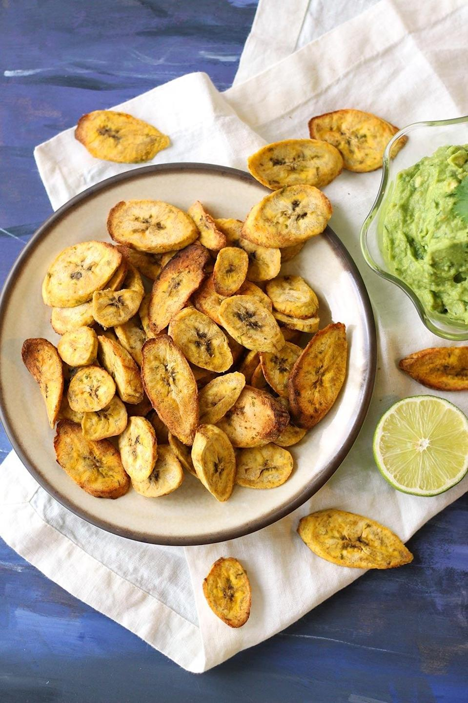 """<p>Craving chips but want something a bit healthier? These plantain crisps are just what you need. Spiced with chili, garlic, and lime, these have a zesty flavor that will keep you coming back for more. When dunked in creamy guacamole, we can almost guarantee that your taste buds will swoon in delight.</p> <p><strong>Get the recipe</strong>: <a href=""""https://zenandzaatar.com/air-fryer-plantain-chips-with-creamy-guacamole/"""" class=""""link rapid-noclick-resp"""" rel=""""nofollow noopener"""" target=""""_blank"""" data-ylk=""""slk:air fryer plantain chips with creamy guacamole"""">air fryer plantain chips with creamy guacamole</a></p>"""