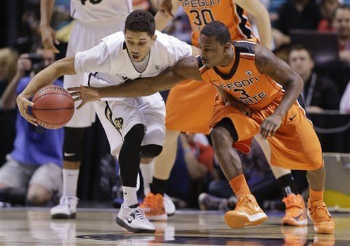 Colorado's Askia Booker, left, keeps the ball away from Oregon State's Ahmad Starks during the first half of a Pac-12 Conference tournament NCAA college basketball game, Wednesday, March 13, 2013, in Las Vegas. (AP Photo/Julie Jacobson)